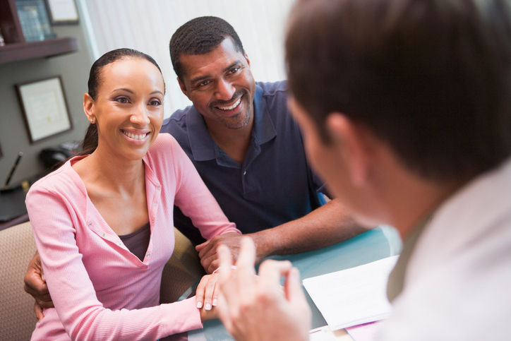 Couple talking with doctor in IVF clinic
