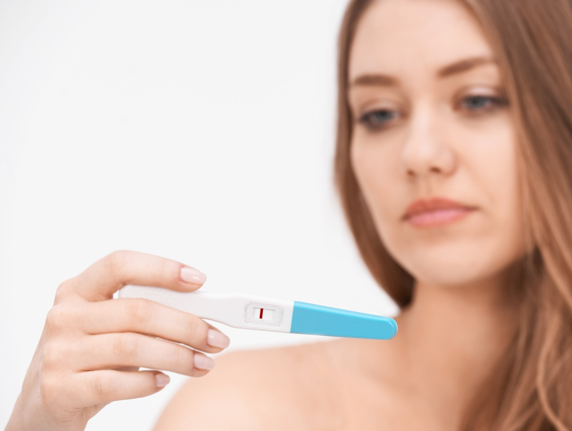 woman holding negative pregnancy test
